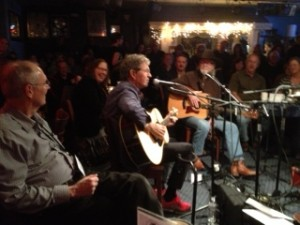 Mac Davis (Center on mic), Hugh Prestwood (Center Rt. on Mic) at the Bluebird Cafe